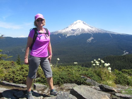 Jeanette poses for a photo with Mt. Hood.