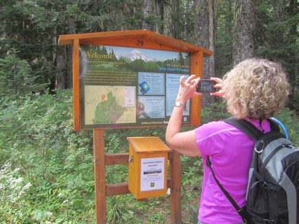 Jeanette gets a photo of the trailhead sign.