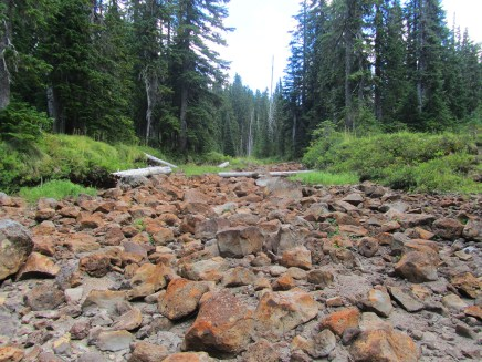 Crossing a dry Rush Creek.