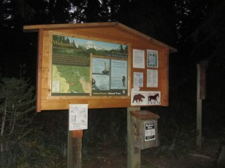 Trailhead sign in and warnings.
