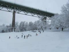 Sledding under the bridge.