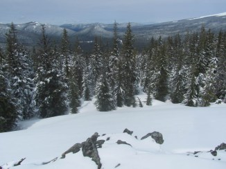 Viewing from the summit to the Northwest. There is normally a small cliff here but this winter there was enough snow to bury it.