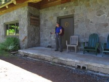 Lori on the porch at Nesika Lodge. We took off our packs and sat in the chairs for lunch.