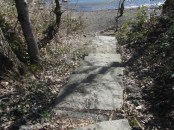 An almost hidden set of stone stairs takes you down to a beach on the Willamette.
