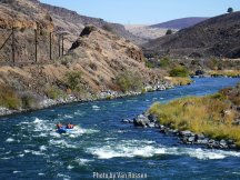 A raft going down the Deschutes River.