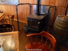 A warm stove for winter and out side seating for summer.
