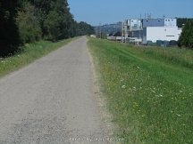 Heading back on the levee trail, industrial park starts on the right.