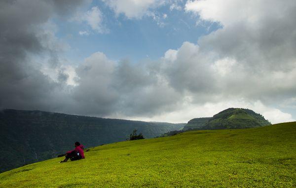A trekker rests atop Garbett Plateau