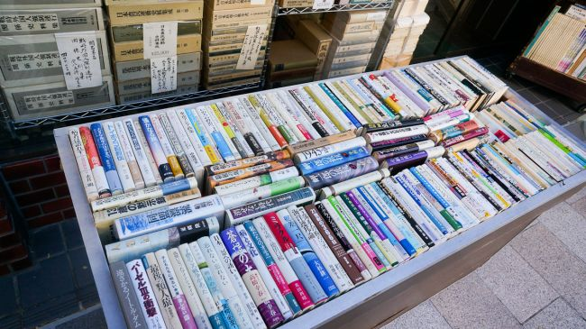 More old books on the streets of Jimbocho, though more colourful ones. (Picture courtesy: Antonio Tajuelo, Flickr)
