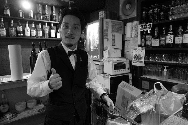 A bartender in one of the bars of Golden Gai (John Sonderman / Flickr)