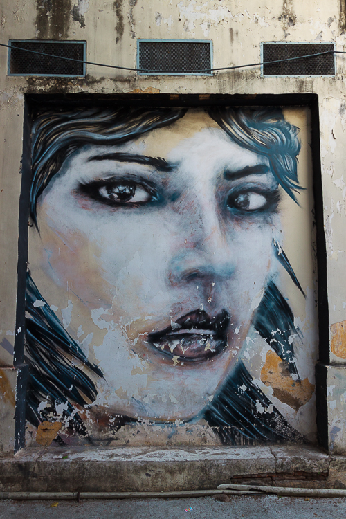 An edgy mural stares out from a wall