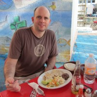 Rich eating fish lunch