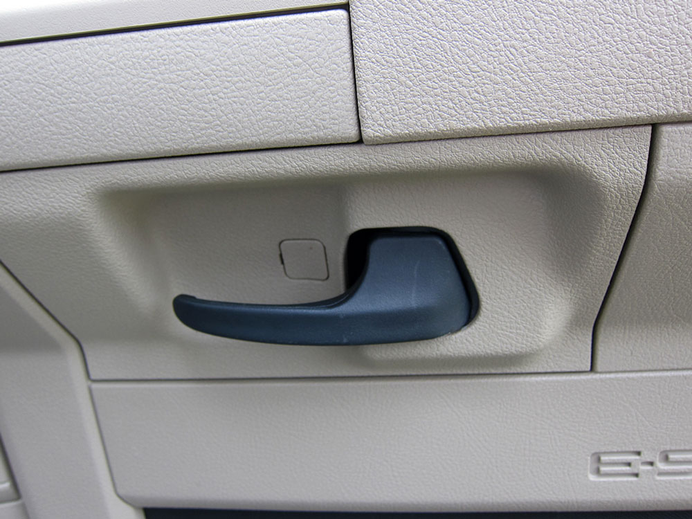The last 2 screws are near the door handle.