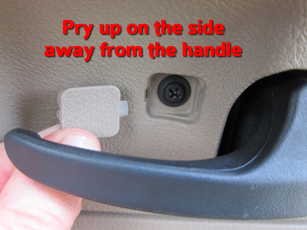 Pry up the screw cover from the right-hand side then remove the screw.
