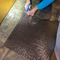 Kathy trimmed the carpet tiles