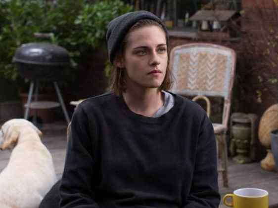 Kristen Stewart wearing a beanie and a dog is in the background, she will be starring in Happiest Season, one of the queer movies coming in 2020