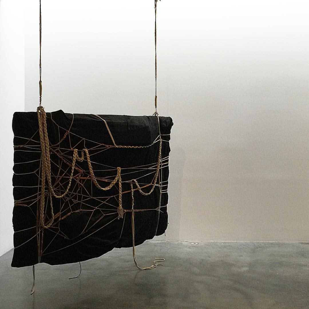 Laura Lima, Sem titulo (Agrafo), 2015, black tissue and dyed rope.