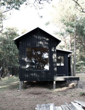 A Wooden House That's Simple On The Outside But Modern On The Inside 26