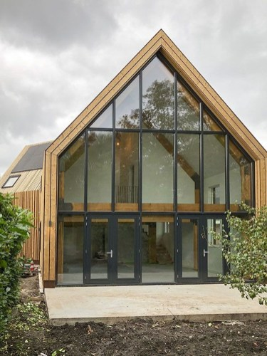 A Wooden House That's Simple On The Outside But Modern On The Inside 44