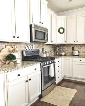 Captivating White Cabinets Design Ideas For Kitchen06
