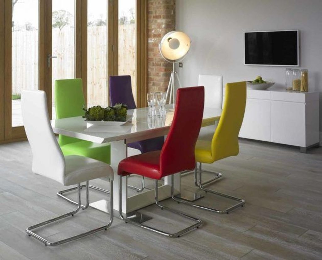 Stunning Dining Room Design Ideas With Multicolored Chairs29