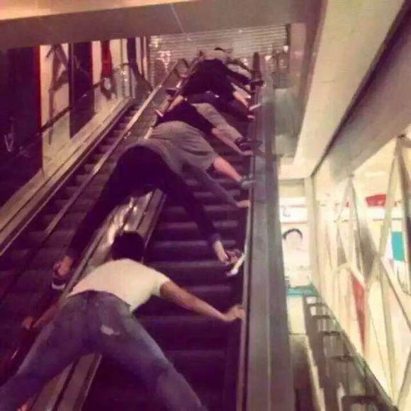 Another dangerous outrageous way to ride the escalators