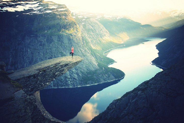 Performing yoga on Trolltunga, Norway
