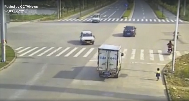 Child in Fear Runs Across the Road
