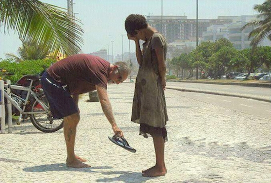 Man giving girl his own slippers