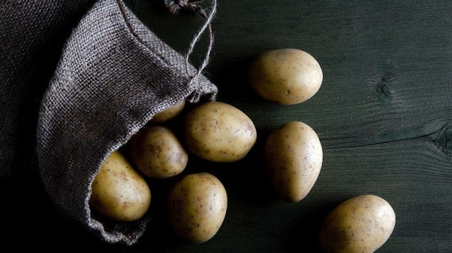 Store potatoes in a dark area