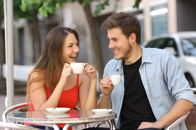 Boy and girl conversation on a tea