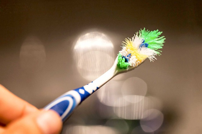 Not changing your toothbrush