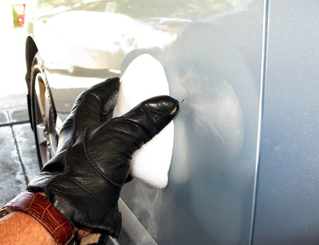 Removing hail dents with dry ice