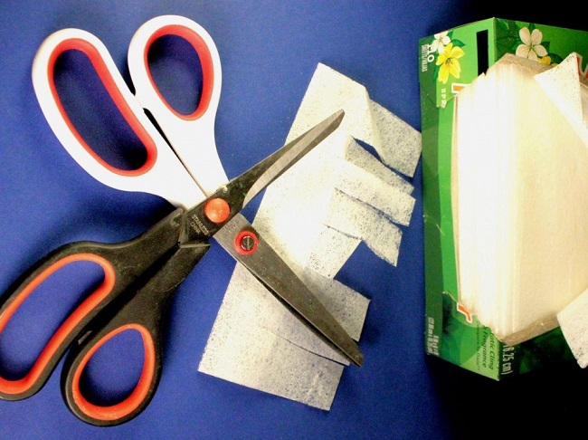 Sharpen scissors with dryer sheets