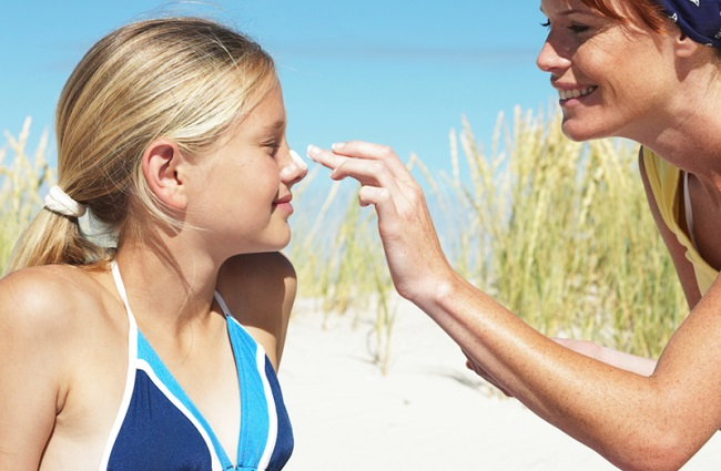 Applying Sunscreen on kids face