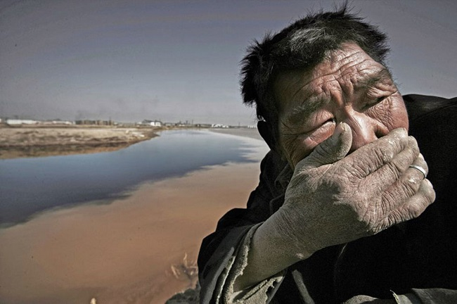 Polluted yellow river Mongolia