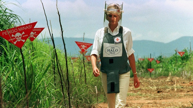 Diana, Princess of Wales, walks in one of the safety corridors of the land mine field of Huambo, Jan..