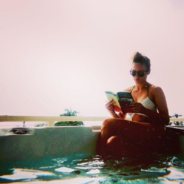 Brie loves reading by the pool