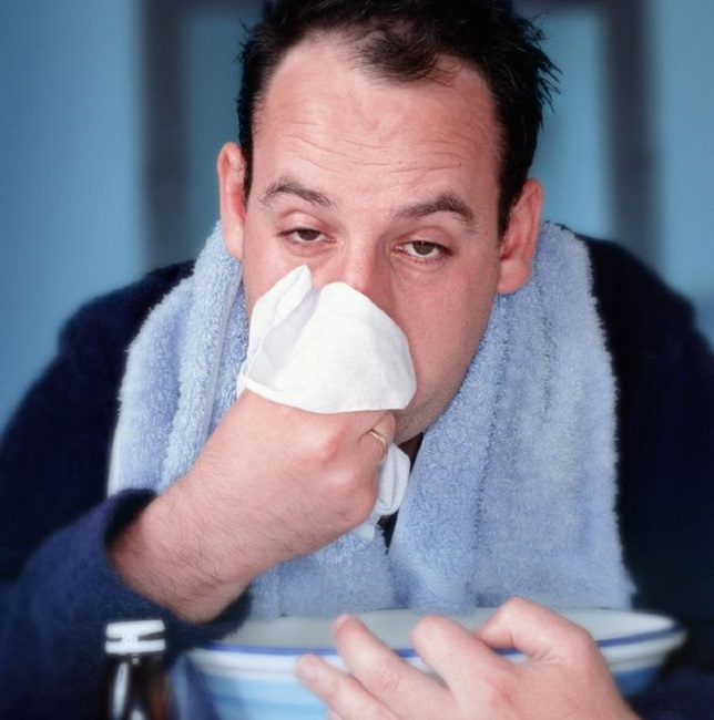 Man blowing nose