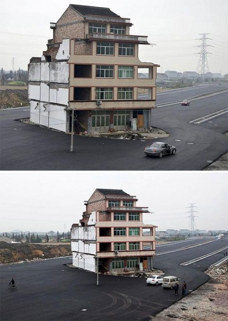 House in middle of the road