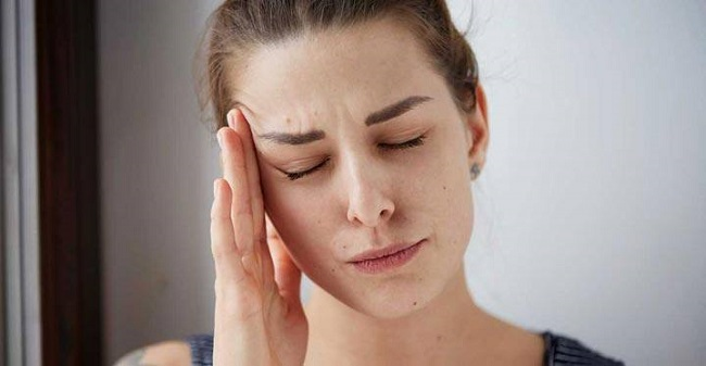 Woman suffering Headaches