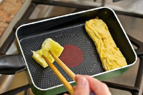 Japanese cook omelets in a special four-sided frying pan