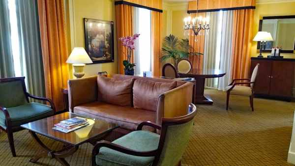 Plush furnishings inside one of the corner suites at the InterContinental Mark Hopkins Hotel