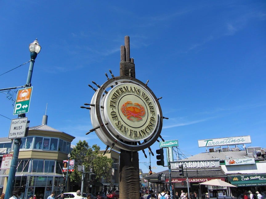 Fisherman's Wharf sign with the famous crab stands in the winter background