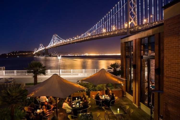 Waterbar restaurant overlooking the Bay Bridge and the Bay Lights art-light display