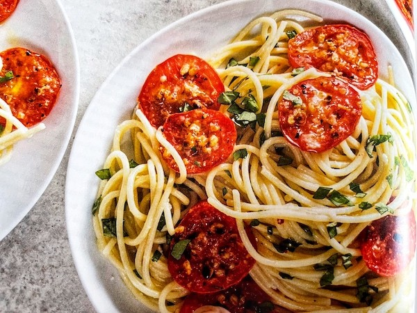 Garlicky spaghetti with basil and broiled tomatoes recipe from ATK