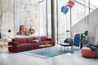 Wohnzimmereinrichtung mit freigelegter Ziegelwand ...
