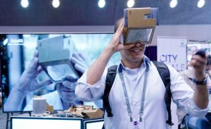 Man looking through a AR device called a holokit.