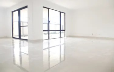 Empty room with porcelain tile flooring