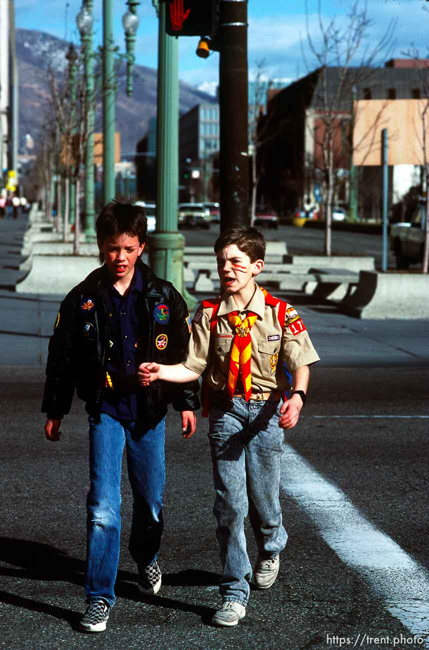 Two scouts walking downtown (100 S, W Temple) to the Scout-a-rama at the Salt Palace, march 1988.
